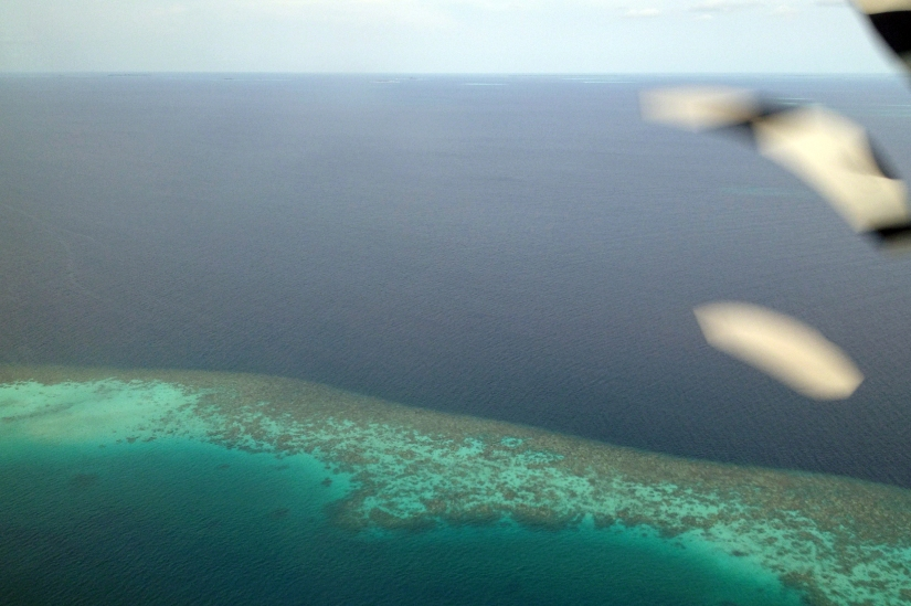 Flying over the Maldives in a Twin Otter float plane